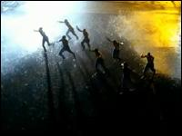 Men dance in the rain