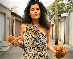 Nelly Furtado dressed as a cavewoman