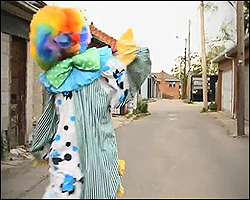 Nelly Furtado dressed as a clown