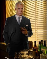 John Slattery as Mad Men's Roger Sterling